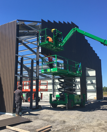 wall_cladding_going_up_for_a_new_6600_sq_ft_kodiak_steel_building
