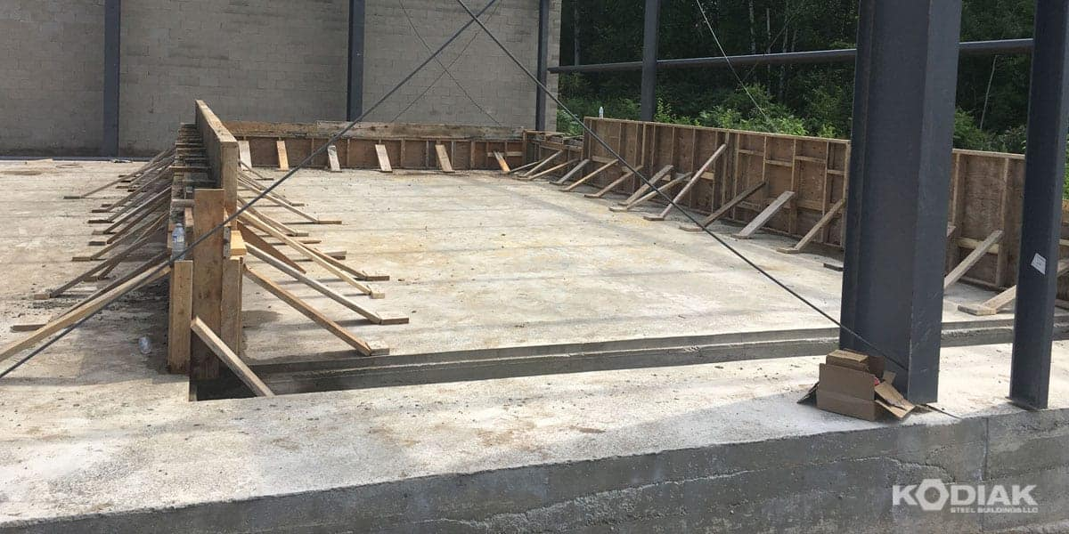 setting the steel building foundation